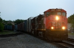 The Class Dash 9-44CWL leads an eastbound at dusk