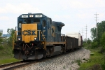CSX 7611 leads Q327 west approaching Breton Ave.