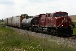 CP 8781 leads X500 slowly east into the siding