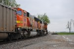 A BNSF signal fixer watches southbound coal pass by
