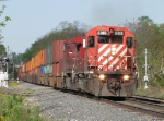 CP 6016 leads X500-03 east with a long block of double stack at the headend