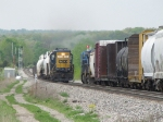 With L326 stopped in the siding, Y106 passes it heading west