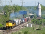 The GP40's of GDLK120 spew exhaust as they roll past the Country Fresh spur and silo