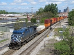Under sunny skies, CEFX 1047 rolls east past Pleasant St with X500-12