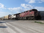 Behind CP 9800 & SOO 6025, X500-18 heads east for Canada