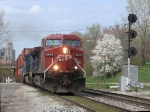X500-12 rolls past the westbound Pleasant St signals as the spring blossoms have begun to emerge