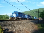Blue sky, blue engines, green leaves, green engines.