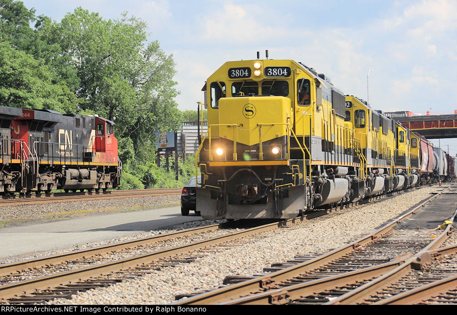 NYS&W WS-3 pulls freight west as a southbound crude oild train with CN power passes on CSX