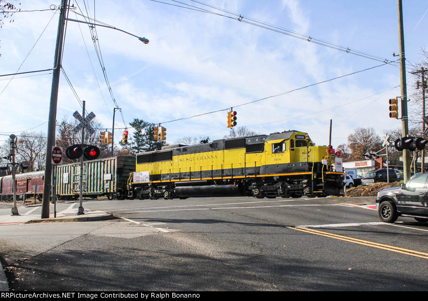 NYS&W SD60  3800 leads the 2017 Toys for Tots train across and upgrade at Goffle Road