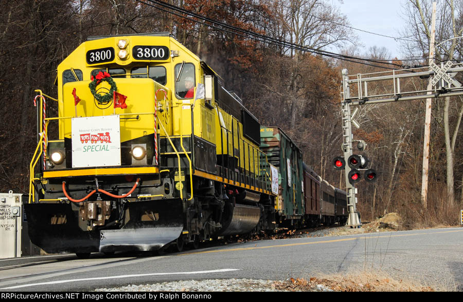The Annual NYS&W Toys for Tots Train, led by SD60 # 3800 starts the climb up Sparta Mountain at Smith Mills crossing