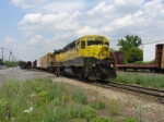Yard crew starts switching the SU-100 out as a southbound rolls by on CSX