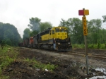 "Conductor gets ready for a ""rolling supply transfer"" at Pelton Road about to enter NS Territory"