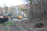 SU-99 starts upgrade crossing Park place, with CSX GP38-2 2732 in the mix
