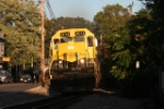 The late afternoon/early evening sun  hits the nose of SD40T-2 3014 as it leads SU-99 uphill into town