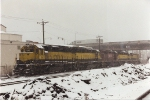 A snowy December day affords this view of road power on layover on the fuel track