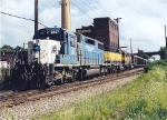 Leased SD38 2807 and leased HATX GP40 bracket the 3040 on an SU-99