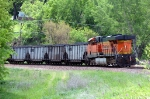 "BNSF 6204, GE ES44AC, eastbound DPU shoves hard against the NS ""Top Gon"" coal loads"