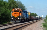 BNSF 2038, EMD GP38-3, has a westbound MofW concrete tie train in tow