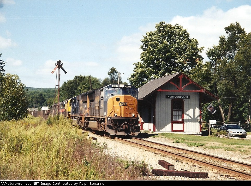 An eastbound CSX/NYSW combination detour train rolls past the station