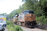 CSX detour train X101-16 passes Rich's Deli, a local trackside landmark as it heads east