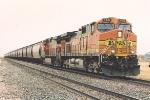 Westbound grain train crawls upgrade