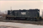 On a dreary wet day in Nov of 1988 N&W GP 35 #232 dances around Homestead yard switching.