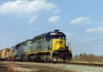 Heading up the limestone train CSX SD40-2 8437 heads south on the former Toledo Terminal at Vickers Oh in 1994