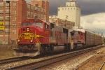 Eastbound vehicle train under stormy skies
