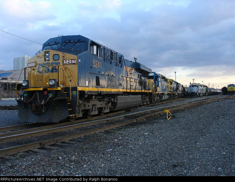 Q273-06 waits at 69th Street to depart northbound in the last light of the day