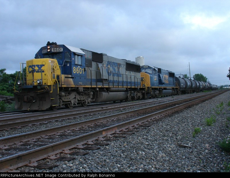 Q 273 waits to head north at the home signal at CP-5 under darkening skies