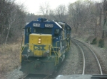 CSX Local C711 takes the siding at CP-102 on an overcast afternoon