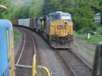 AS Q417 sits in the siding, Q438 rolls past northward on the main