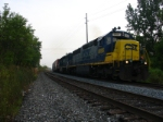 Not a great shot, but still... Q271 rolls north with an ex EL SD45-2 on the point