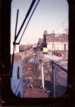 SK-5 works its way east on the Center St ind. track. Siding on the left is now gone