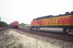 BNSF 4990 meets a CN train.  the CN train is comming off of ex NYC tracks (now NS) onto former GT tracks to Chicago.  CN and NS share tracks for about a mile or so.