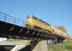 UP 369 hauls CNW hoppers on this ex-CNW bridge