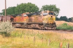 Westbound grain train waits to enter yard