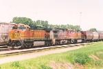 Westbound grain train waits in yard