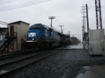 Eastbound NS empty stacks in the rain
