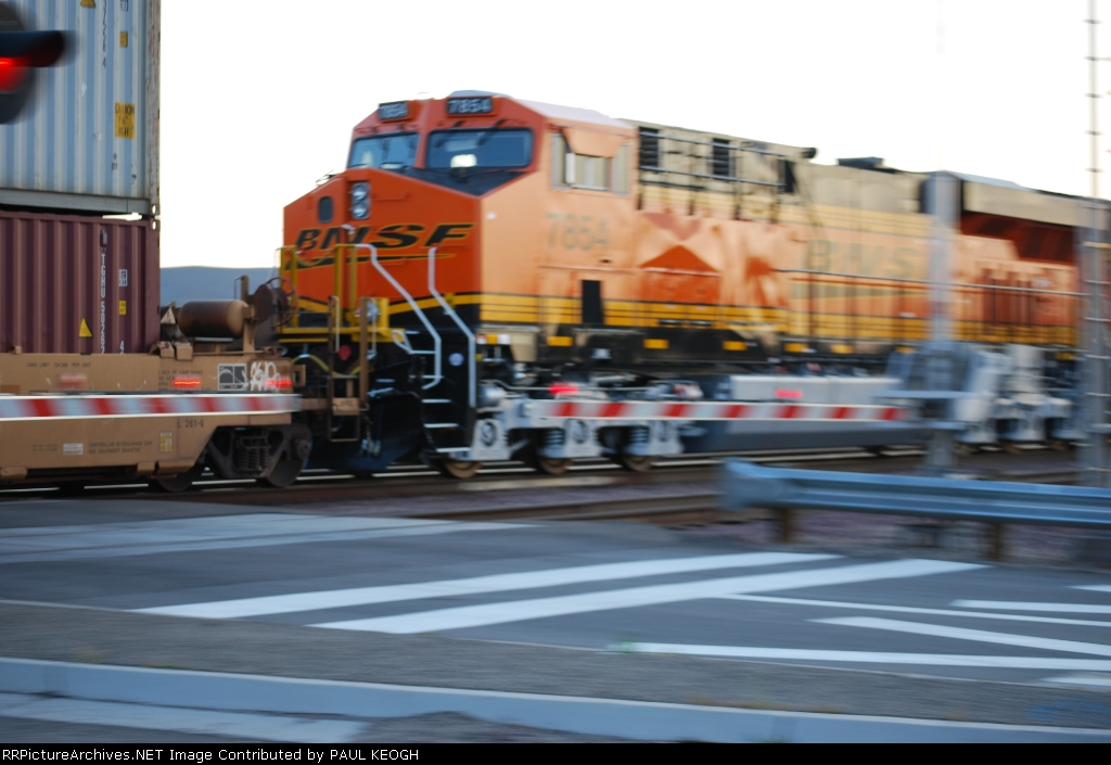 BNSF 7854 crosses over the Daggett-Yermo Road as she rolls west as the # 4 unit on a westbound Z with BNSF 7856 and BNSF 7855 in front of her.