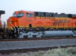 BNSF 7856 Blurs the camera lens as she rolls west.
