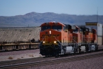 BNSF 7849 pulls out of BNSF Barstow yard leading a Hot westbound Z with her sister BNSF 7850 as the third unit in this three locomotive consist.