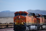 Close up shot of a Brand new ES44DC BNSF 7849 (You can clearlly see the engineer and conductor) as she pulls a Hot Z westbound.