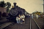 Family portrait next to Steam Locomotive 497