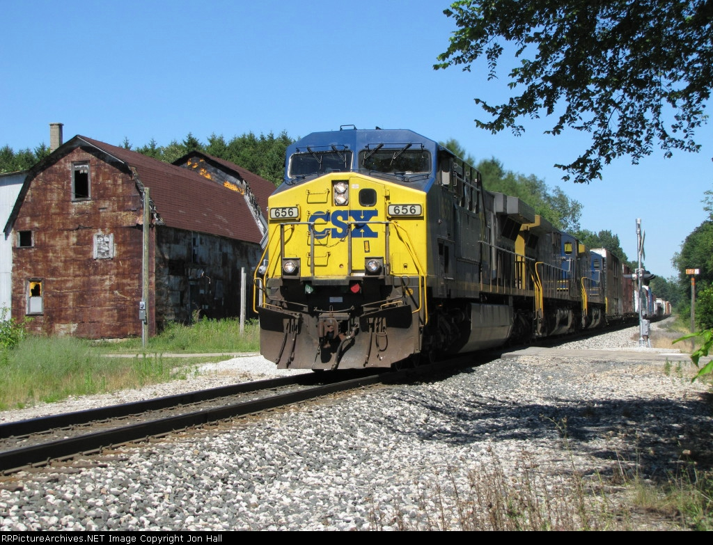 With two AC4400's trailing, CSX 656 powers Q327-03 over the crossing