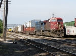 Q326's power sits near the tower as a yard crew drags X500-20 through 2 Track