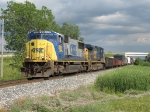 CSX 4506 & 7926 lead Q335-09 out from under the day's cloud cover