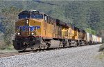 UP 5450 (ES44AC) works a westbound manifest up Cajon Pass CA. 4/23/2010