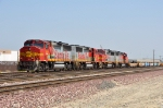 BNSF 150 (ex ATSF GP60M 150) leads a lashup of red and silver GP60M's on an empty intermodal train at Verdemont CA. 4/23/2010