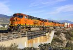 BNSF 7434 leads east bound stacks at Verdemont Ca. 1/4/2011